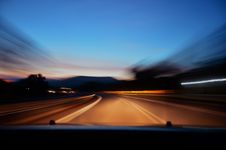 Free Car Driving On Road At Sunset Stock Images - 82964924
