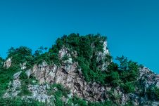 Free Tree Covered Rocky Crag Stock Images - 82965454