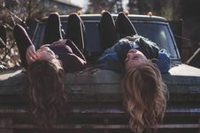 Free Girls Lying On Bonnet Of Four By Four Royalty Free Stock Photos - 82965718