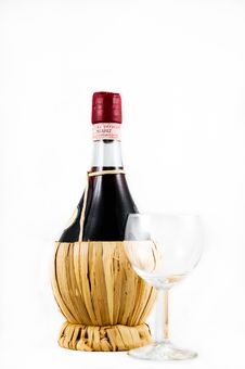 Free Clear Wine Glass Beside Red Wine Bottle Royalty Free Stock Photos - 82965808