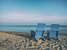 Free Wooden Beach Chairs On Sandy Beach Stock Photos - 82973713