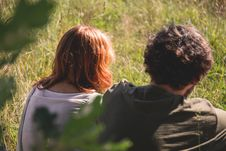 Free People Photography Of Man And Woman Sitting On Green Grass Field Stock Image - 82974231