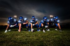 Free Football Players In Blue Jersey Lined Under Grey White Cloudy Sky During Sunset Royalty Free Stock Photography - 82974897
