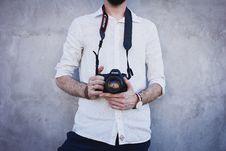 Free Man Wearing White Long Sleeves Holding Black Canon Dslr Camera Stock Image - 82975091