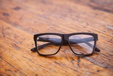 Free Black Frame Wayfarer Eyeglasses On Brown Wooden Surface Stock Photo - 82975270
