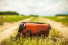 Free Leather Bag On Country Lane Stock Photo - 82976300