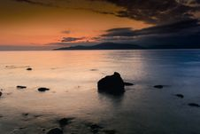 Free Rocks On Coastline At Sunset Stock Image - 82976371