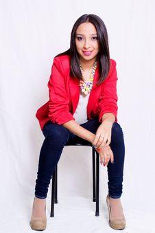 Free Woman Wearing Red Blazer Sitting On Black Stool Royalty Free Stock Image - 82976826