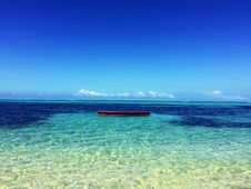 Free Boat In The Middle Of Atoll Photo Royalty Free Stock Photo - 82977315