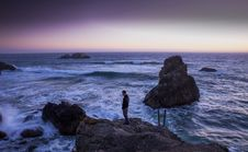 Free Man In Black Shirt Standing On Rock In Between Sea Water Royalty Free Stock Image - 82977506