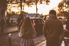 Free Man In Brown Jacket Beside Woman In Grey Jacket During Sunset Stock Image - 82977751