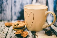 Free Beige Ceramic Heart Mug With Coffee Beside Cookie Food Stock Images - 82977824