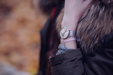 Free Woman In Brown Parka Jacket With Gold Round Analog Watch Stock Photography - 82977832