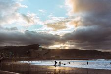 Free Surfers On Beach Royalty Free Stock Images - 82978409
