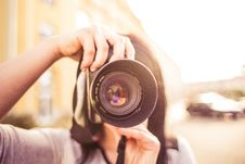 Free Woman In Gray Shirt Taking A Photo Shoot During Day Time Stock Photo - 82978470