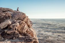 Free Man On Cliff Over Desert Stock Photos - 82978473