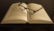 Free Black Frame Eyeglass In White Printed Book Page Royalty Free Stock Photos - 82978738