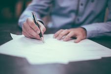 Free Man Signing Papers Royalty Free Stock Photography - 82979127