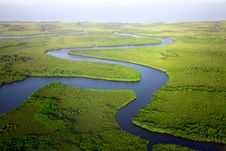 Free River Running Through Marshlands Royalty Free Stock Photography - 82979247