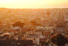 Free Sun Setting Over Urban Roof Tops Royalty Free Stock Images - 82979569
