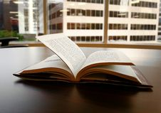 Free Open Book On Desktop Stock Photography - 82979582