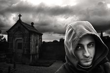 Free Man In Hoodie In Cemetery Royalty Free Stock Photos - 82979618