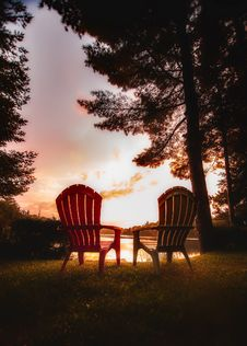 Free Chairs On Table Against Trees During Sunset Stock Images - 82979674