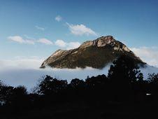 Free Mountain Peak Through Clouds Royalty Free Stock Photo - 82980175