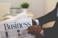 Free Man Reading Business Pages Royalty Free Stock Images - 82980369
