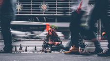 Free Man Selling On Streets Royalty Free Stock Photography - 82980407