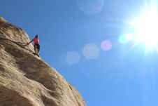 Free Man Climbing Cliff Stock Photography - 82980432