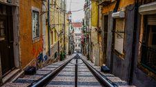 Free Rails Down Narrow Alley Royalty Free Stock Photos - 82980458