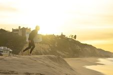Free Surfer On Sandy Beach At Sunrise Royalty Free Stock Photos - 82980708
