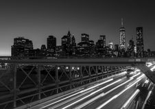 Free Grey Scale And Time Lapse Photography Of A Bridge With Car During Night Time Stock Photos - 82980983