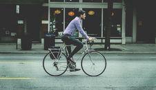 Free Man Riding Bicycle Royalty Free Stock Image - 82981486