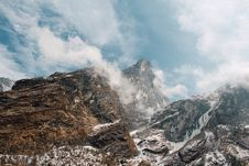 Free Cloudscape Over Snowy Mountain Peaks Royalty Free Stock Photos - 82981568