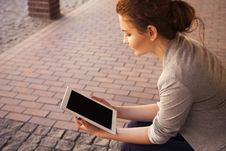 Free Young Woman Using A Tablet Royalty Free Stock Images - 82982659