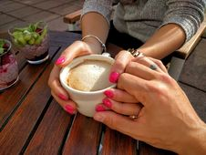 Free Midsection Of Woman Holding Coffee Cup On Table Stock Images - 82982864