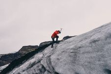 Free Mountaineer On Cliff Royalty Free Stock Image - 82982896