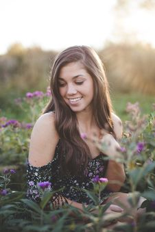 Free Selective Focus Woman Surrounded By Flower Stock Photography - 82982992