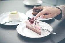 Free Hand Over Desserts Royalty Free Stock Photo - 82983195