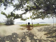 Free Woman In White Bikini Using Swing Under Green Leaf Tree During Daytime Royalty Free Stock Images - 82983409
