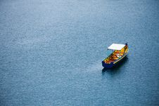 Free Wooden Boat On Blue Waters Royalty Free Stock Photo - 82983735