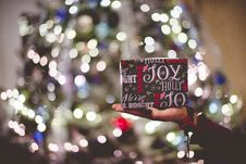 Free Close-up Of Hand Holding Christmas Present Royalty Free Stock Image - 82983756
