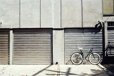 Free Bicycle Outside Garage Royalty Free Stock Image - 82983956