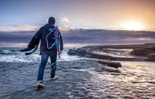 Free Man In Blue Hoodie And Denim Pants On Seashore Stock Image - 82984511