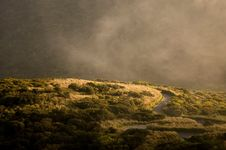 Free Windy Road On Foggy Hillside Royalty Free Stock Photography - 82984797