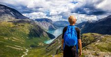 Free Hiker On Mountain Peak Stock Images - 82985014