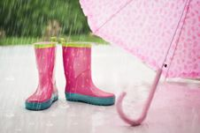 Free Red And Gray Rain Boots Near Pink Umbrella Stock Photography - 82985022