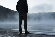 Free Man Standing On Lakefront On Foggy Day Royalty Free Stock Photography - 82985387